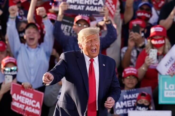 President Donald Trump works the crowd after speaking at a campaign rally Monday, Oct. 19, 2020, in Tucson, Ariz. (AP Photo…