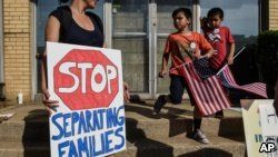 People protest against recent U.S. immigration policy that separates children from their families when they enter the US as undocumented immigrants, in front of a Homeland Security facility in Elizabeth, New Jersey, June 17, 2018.