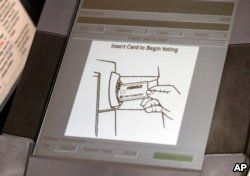 This photo shows a touchscreen of a voting machine during early voting in Sandy Springs, Ga., May 9, 2018. The fact that many voting machines used by Americans do not produce paper records worries cybersecurity experts.