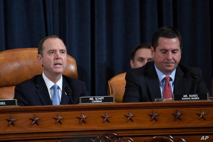 House Intelligence Committee Chairman Adam Schiff of Calif., left, speaks as Rep. Devin Nunes, R-Calif., listens.