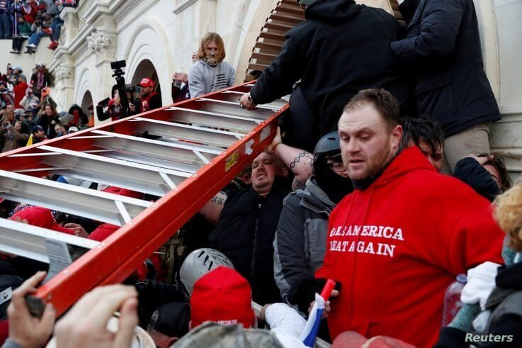 FILE - Pro-Trump protesters storm into U.S. Capitol during clashes with police.