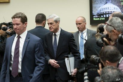 Escorted by a security detail, former special counsel Robert Mueller arrives to testify to the House Judiciary Committee about his investigation into President Donald Trump and Russian interference in the 2016 election, on Capitol Hill in Washington…