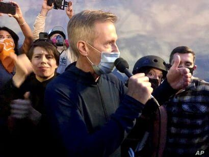 Mayor Ted Wheeler speaks to people gathered in downtown Portland, Ore., Wednesday, July 22, 2020. Wheeler faced a hostile crowd…