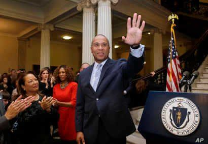 FILE - Massachusetts Gov. Deval Patrick, center, waves to people in the audience as his wife Diane Bemus, left, looks on at the conclusion of ceremonies for the unveiling of his official state portrait, Jan. 4, 2015, at the Statehouse, in Boston.