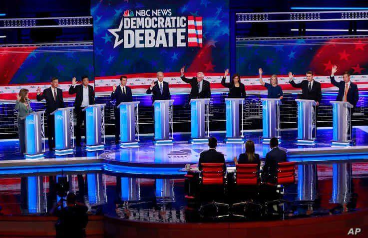 In this June 27, 2019 photo, Democratic presidential candidates, author Marianne Williamson, former Colorado Gov. John…
