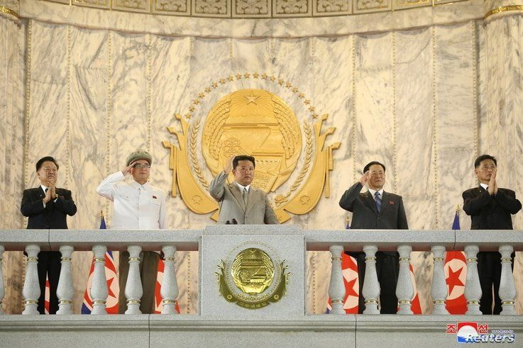 North Korea leader Kim Jong Un (C) attends a paramilitary parade held to mark the 73rd founding anniversary of the republic at…