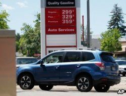 Prices for the three grades of gasoline light up the pump at a Conoco station, May 25, 018, in east Denver. Memorial Day vacationers are facing the highest prices at the pumps since 2014 as the average cost of a gallon of regular unleaded is just less than $3.