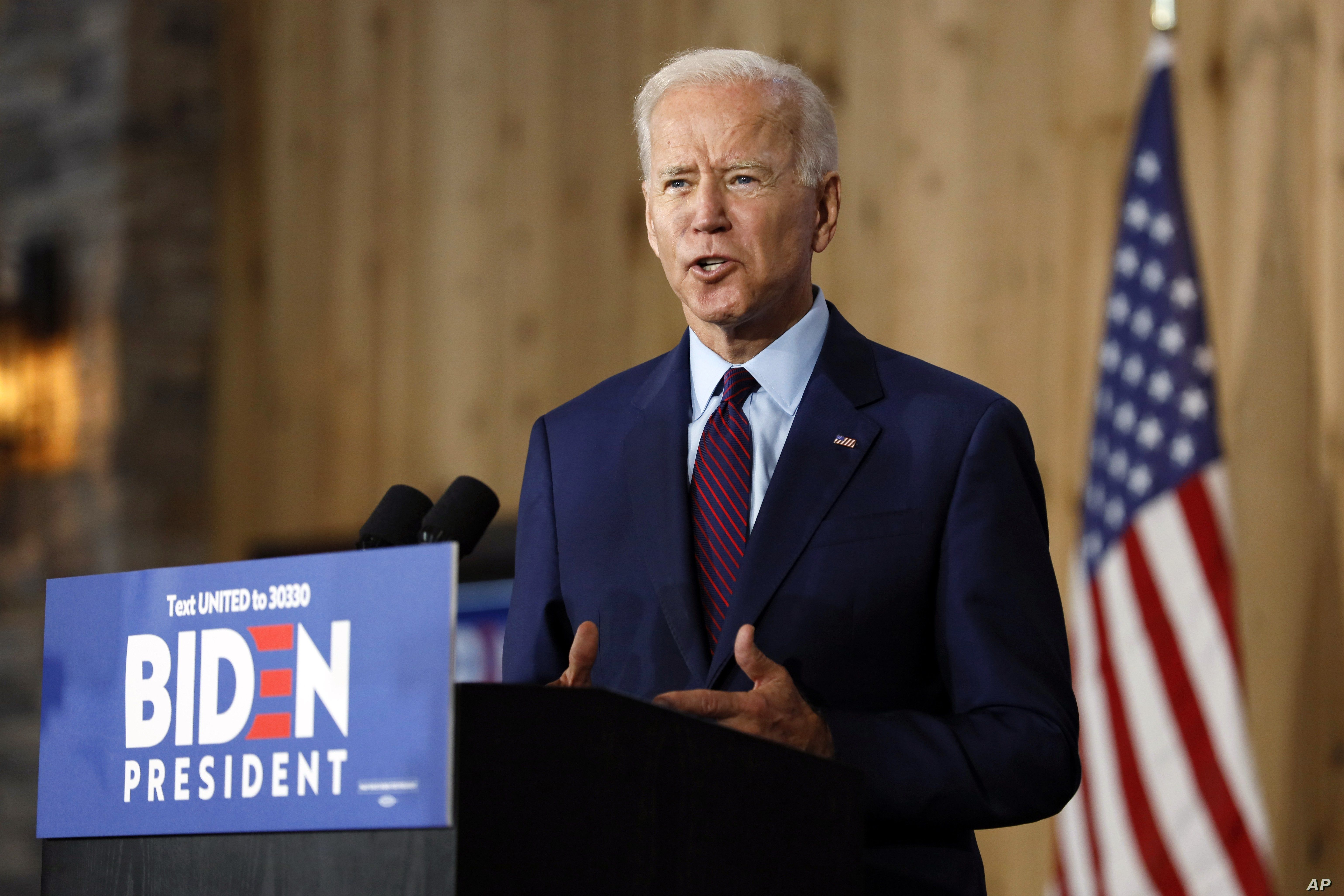 Democratic presidential candidate former Vice President Joe Biden speaks to local residents during a community event, Wednesday, Aug. 7, 2019, in Burlington, Iowa. (AP Photo/Charlie Neibergall)