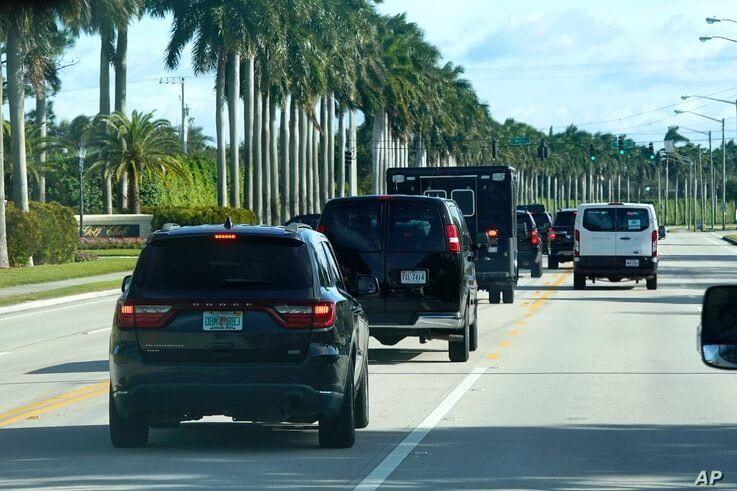 President Donald Trump's motorcade drives to Trump International Golf Club, Friday, Dec. 25, 2020, in West Palm Beach, Fla. (AP…