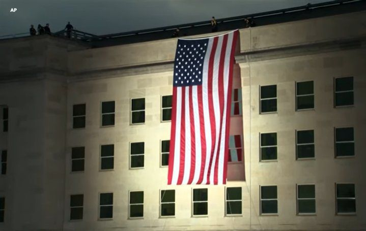 September 11 Marked with Flag Unfurling from Pentagon