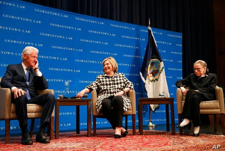 Former President Bill Clinton, left, Hillary Clinton, and Supreme Court Justice Ruth Bader Ginsburg, Oct. 30, 2019, in Washington.