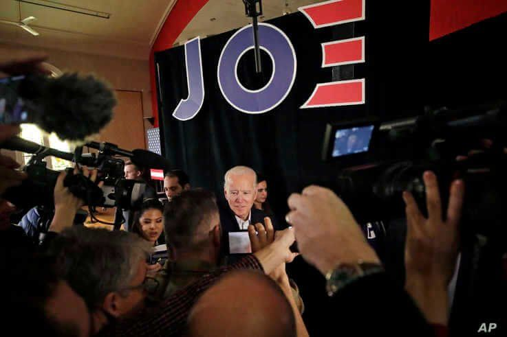 Democratic presidential candidate former Vice President Joe Biden is surrounded at a campaign event, Wednesday, Feb. 5, 2020,…
