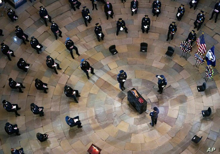 Mourners pay their respects during a ceremony memorializing U.S. Capitol Police officer Brian Sicknick, as an urn with his…