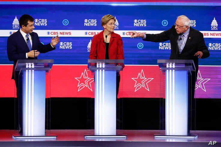 From left, Democratic presidential candidates, former South Bend Mayor Pete Buttigieg, Sen. Elizabeth Warren, D-Mass., and Sen…