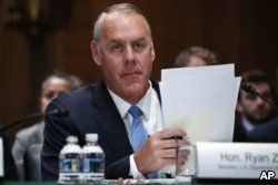 FILE - Interior Secretary Ryan Zinke arrives for a Senate Appropriations subcommittee hearing on the fiscal 2019 budget on Capitol Hill in Washington, May 10, 2018.