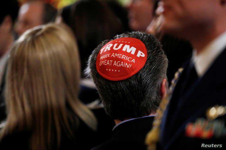 "A participant wears a Trump ""Make America Great Again"" yarmulke as they attend a White House Hanukkah reception where U.S…"
