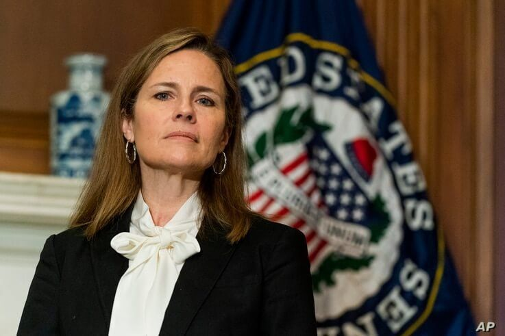 Supreme Court nominee Judge Amy Coney Barrett listens as Sen. Jerry Moran, R-Ks., not shown, speaks during their meeting on…