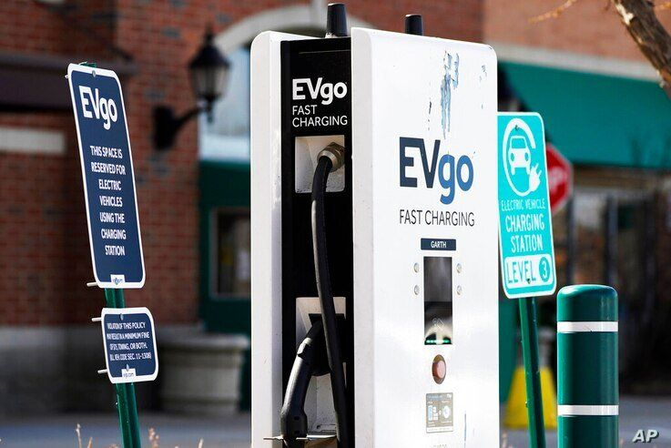 A EVgo electric vehicle charging station is seen at Willow Festival shopping plaza parking lot in Northbrook, Ill., Wednesday,…
