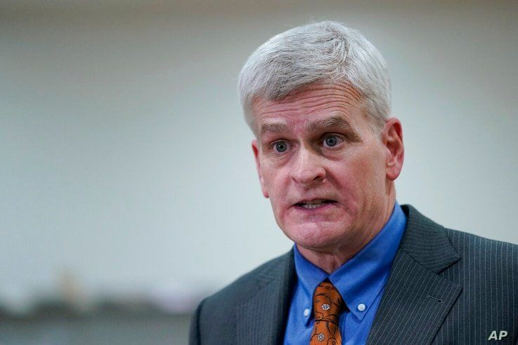 Sen. Bill Cassidy, R-La., talks with reporters on Capitol Hill in Washington, Thursday, Feb. 11, 2021, at the conclusion of the…