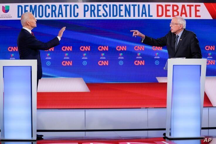 Former Vice President Joe Biden, left, and Sen. Bernie Sanders, I-Vt., right, participate in a Democratic presidential primary…