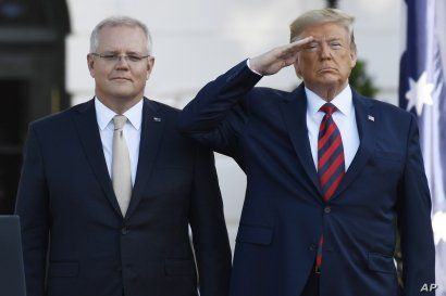 President Donald Trump and Australian Prime Minister Scott Morrison listen to the National Anthem during an State Arrival Ceremony on the South Lawn of the White House in Washington, Friday, Sept. 20, 2019.