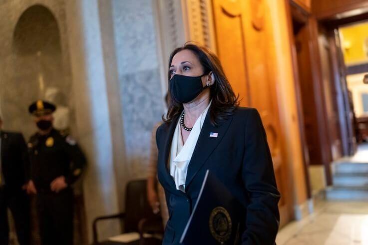 Vice President-elect Sen. Kamala Harris, D-Calif., walks from the Senate chamber after voting against President Donald Trump's…