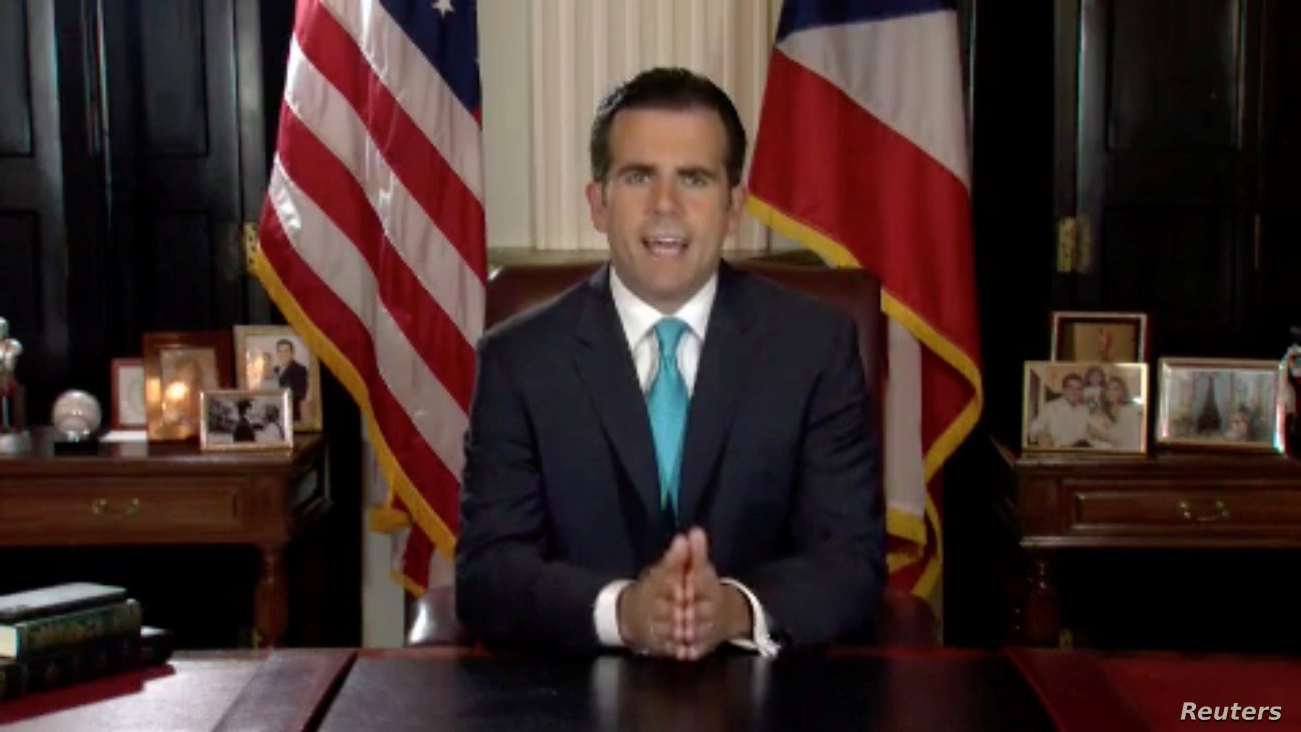 Puerto Rico Governor Ricardo Rossello speaks as he announces his resignation in San Juan, Puerto Rico, early July 25, 2019.