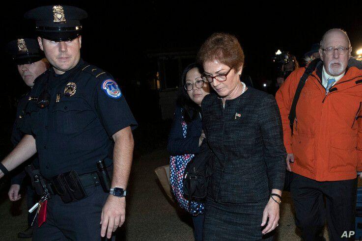 Former U.S. ambassador to Ukraine Marie Yovanovitch, center, leaves Capitol Hill, Friday, Oct. 11, 2019, in Washington, after…