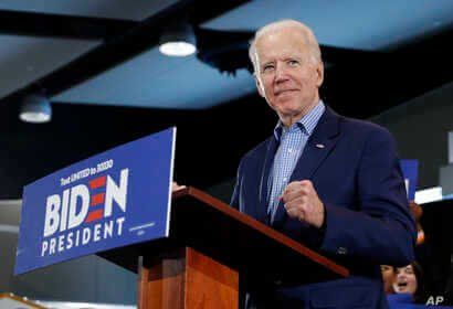 Democratic presidential candidate former Vice President Joe Biden gestures as he speaks during a caucus night event Saturday,…