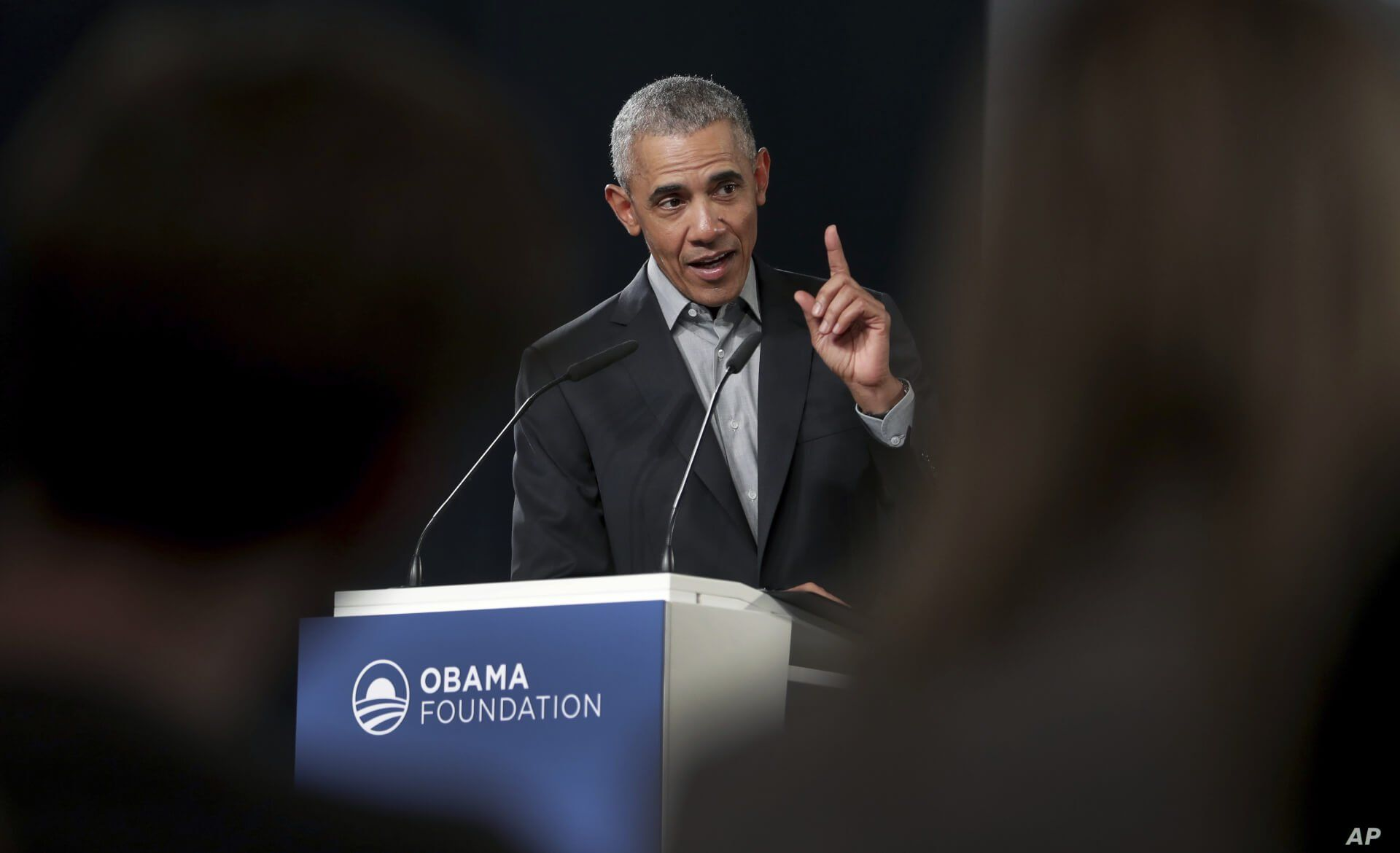 FILE - Former U.S. President Barack Obama gestures as he speaks during a town hall meeting at the European School For Management And Technology in Berlin, Germany, April 6, 2019.