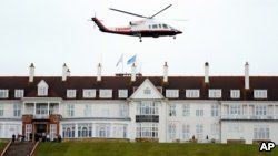 FILE - Then-presidential candidate Donald Trump leaves by his helicopter from the Turnberry golf course in Turnberry, Scotland, Aug. 1, 2015.