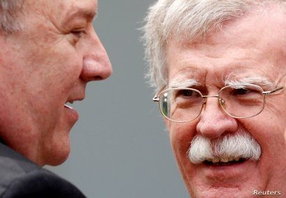 FILE PHOTO: U.S. Secretary of State Mike Pompeo talks with national security adviser John Bolton prior to a joint news conference between President Donald Trump and Japanese Prime Minister Shinzo Abe in the Rose Garden of the White House in Washington, U.S., June 7, 2018. REUTERS/Kevin Lamarque/File Photo