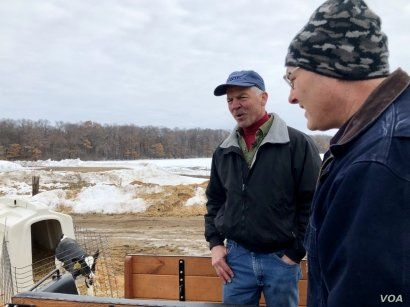 Rep. Steve Stauber talks to a constituent during a tour of Enchanted Dairy, a 1,800-head, family-owned dairy farm in Little Falls, Minnesota. (Photo: C. Presutti)
