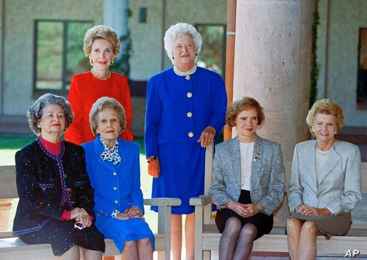 A portrait of former first ladies: Nancy Reagan and Barbara Bush (standing). Seated, left to right: Lady Bird Johnson, Pat Nixon, Rosalynn Carter and Betty Ford, Nov. 4, 1991 in Simi Valley, California.