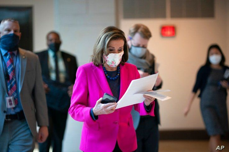FILE - In this Thursday, Feb. 25, 2021 file photo, Speaker of the House Nancy Pelosi, D-Calif., walks to a news conference as…