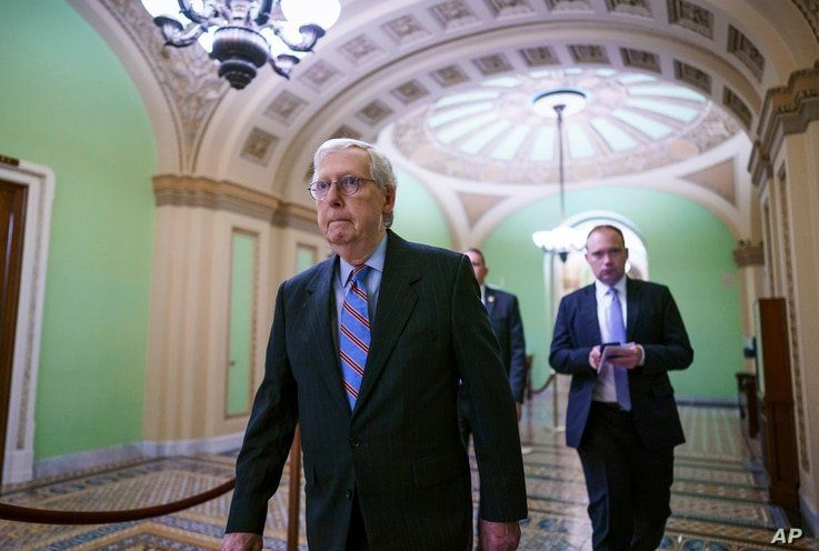 Senate Minority Leader Mitch McConnell, R-Ky., arrives to speak to reporters ahead of a test vote scheduled by Democratic…