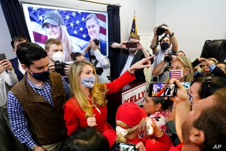 Republican candidate for U.S. Senate Sen. Kelly Loeffler gestures to supporters after speaking at a campaign rally Wednesday,…