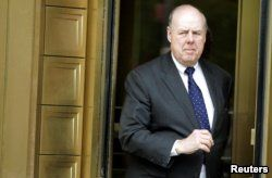 FILE - Lawyer John Dowd exits Manhattan Federal Court in New York, May 11, 2011.