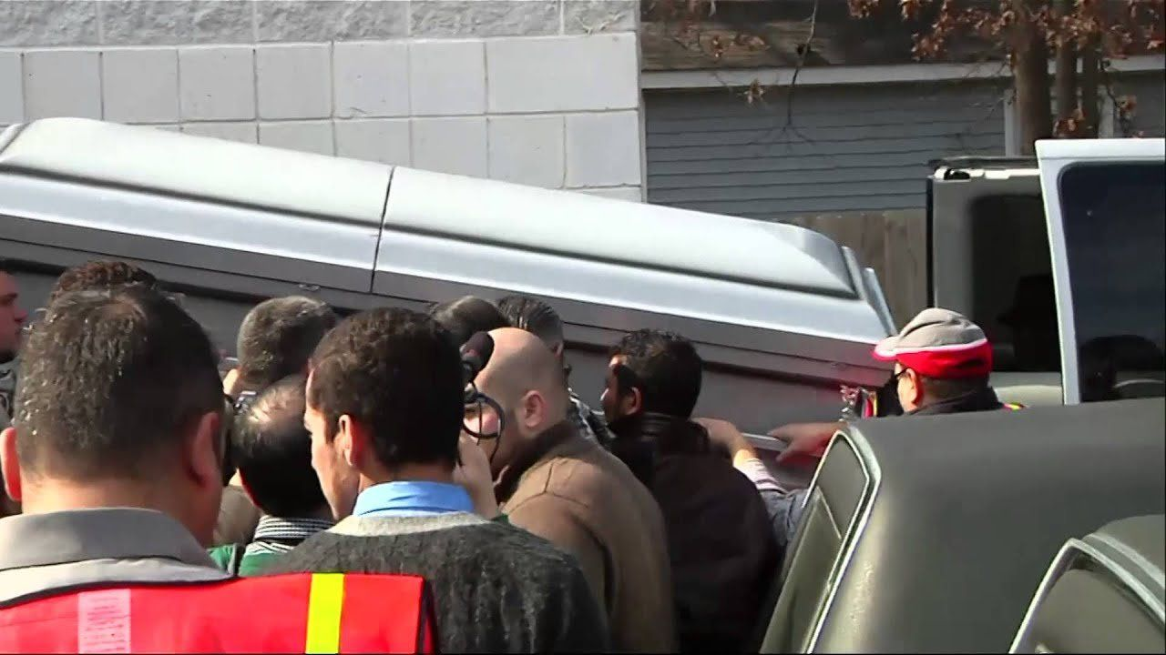 Funeral for slain Muslims draws thousands