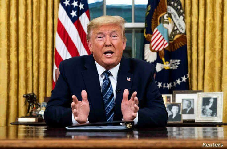 U.S. President Donald Trump speaks about the U.S response to the COVID-19 coronavirus pandemic during an address to the nation…