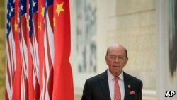 FILE - Commerce Secretary Wilbur Ross arrives at a State Dinner at the Great Hall of the People, Nov. 9, 2017, in Beijing, China.
