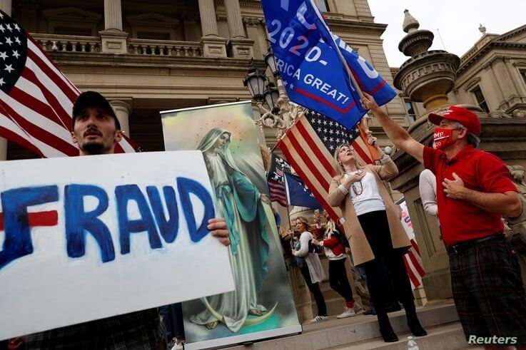 Protesters rally outside Michigan State Capitol building after Joe Biden was declared the winner of the 2020 election.