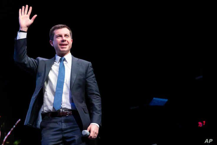 Democratic presidential candidate Pete Buttigieg waves to the crowd during a town hall meeting,  in Concord, New Hampshire, Feb. 5, 2020.