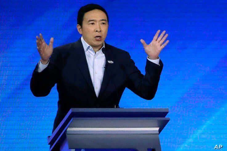 Democratic presidential candidate entrepreneur Andrew Yang speaks during a Democratic presidential primary debate, Friday, Feb…