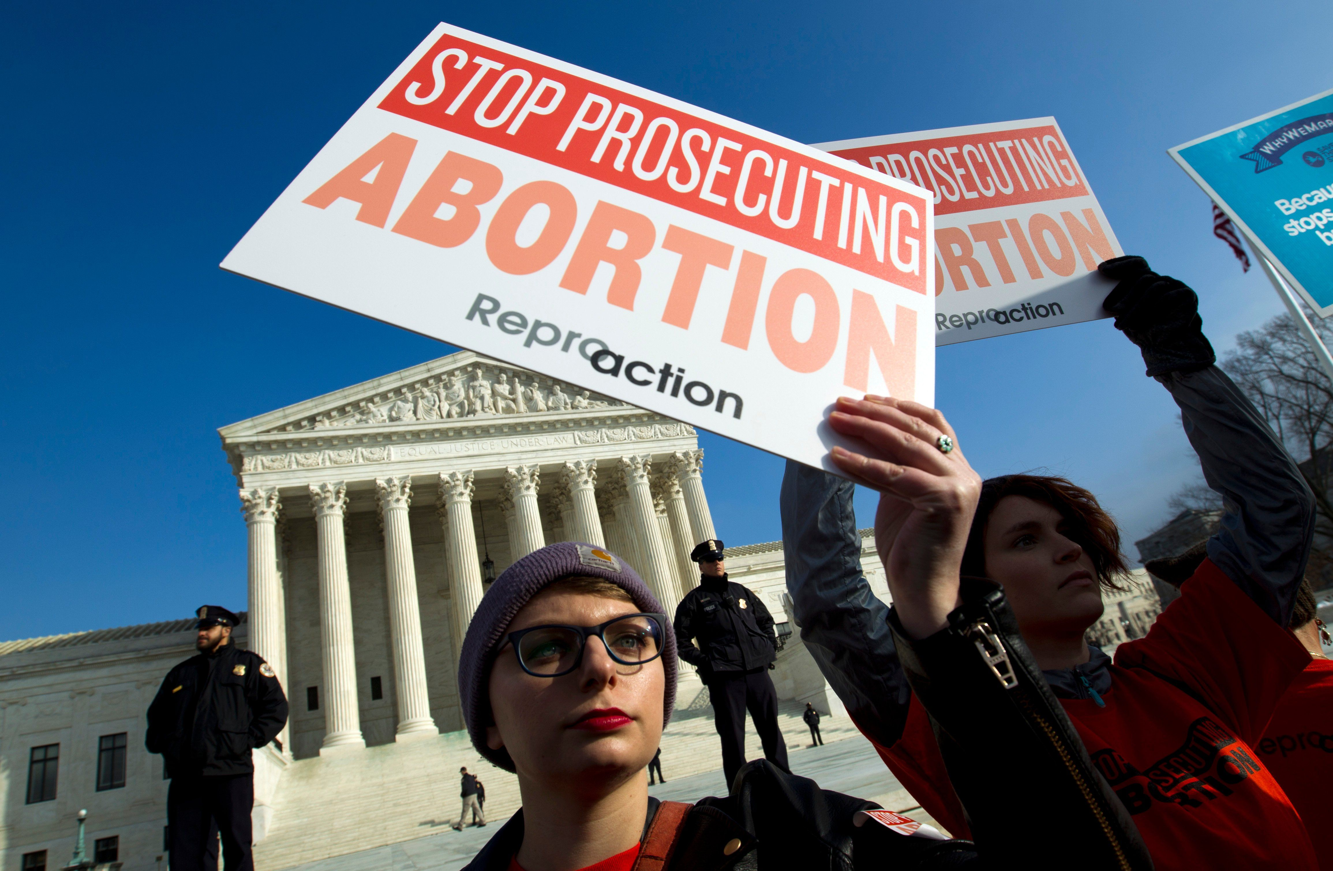 FILE - Abortion rights activists protest outside of the U.S. Supreme Court, during the March for Life in Washington, Jan. 18, 2019.