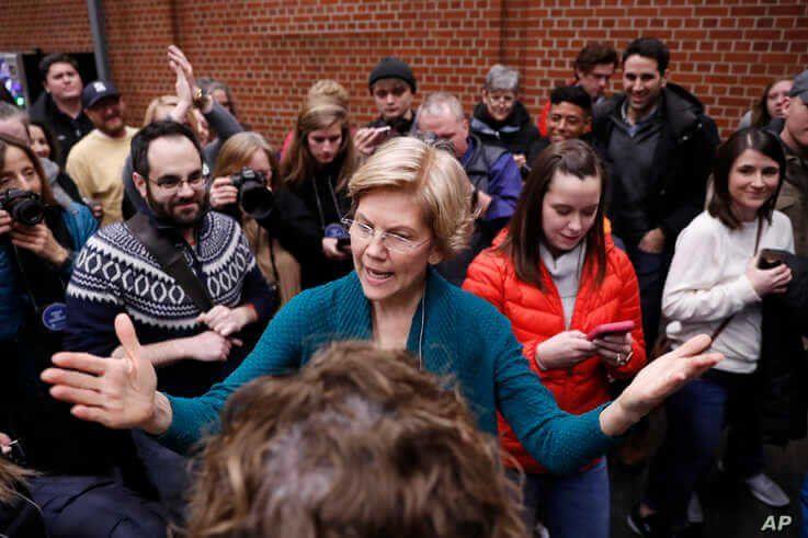 Democratic presidential candidate Sen. Elizabeth Warren, D-Mass., speaks at a caucus at Roosevelt Hight School, Monday, Feb. 3,…