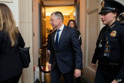 Ambassador Kurt Volker, former special envoy to Ukraine, leaves the hearing room as they conclude a public impeachment hearing…
