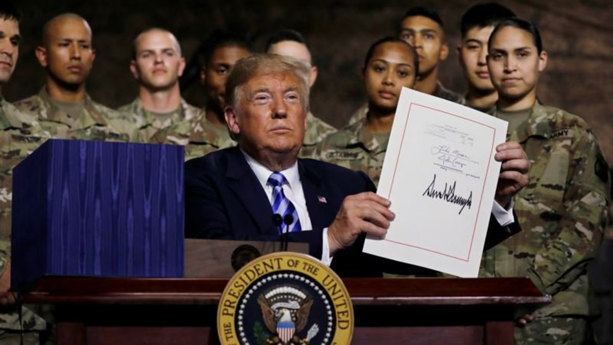 Trump Signs Defense Policy Bill with Watered-down China Measures