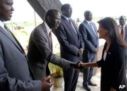 FILE - US Ambassador to the United Nations Nikki Haley, right, meets South Sudanese officials on her arrival in Juba, South Sudan, Oct. 25, 2017. The ambassador, on a three-country Africa visit, met earlier with President Salva Kiir over the country's long civil war.