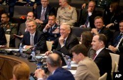 U.S. Secretary for Defense Jim Mattis, center, and NATO Secretary General Jens Stoltenberg, left front, prepare to address a round table meeting of NATO ministers and partners to combat the Islamic State at NATO headquarters in Brussels, Friday, June 8, 2018.